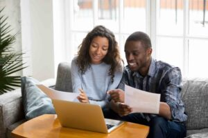 Young black couple investing